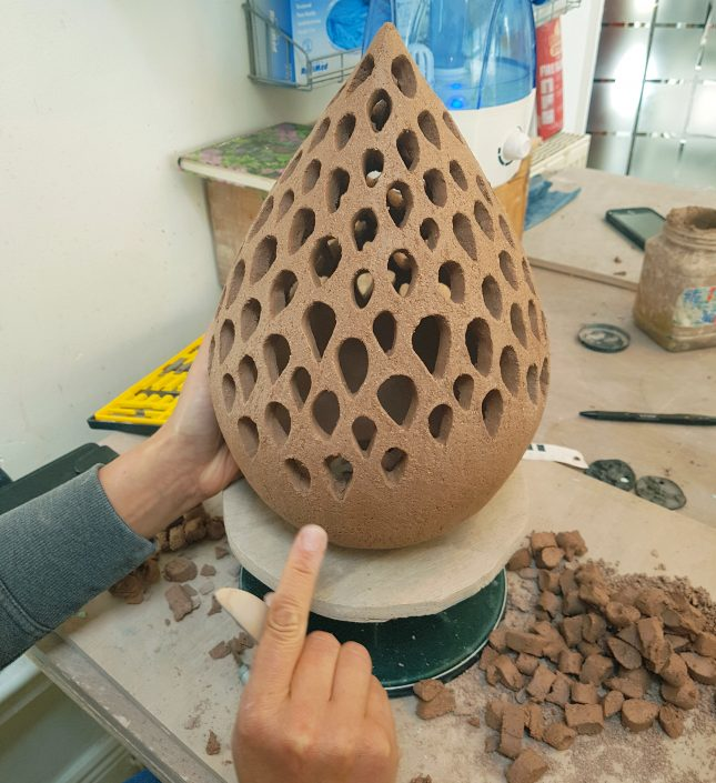 Coil built lamp by Herle Mette Andersen. www.ceramicforms.com