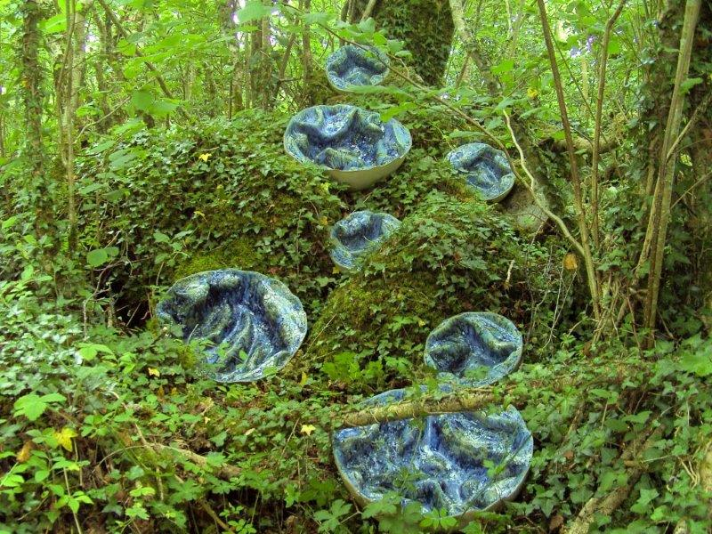 Ceramic outdoor sculpture Puffballs: From the Inside Out by Michelle Maher at Sculpture in the Gardens at Brigit's Garden, Co. Galway. This sculpture is inspired by the internal structure of Puffball fungi and seascapes from the Burren in Co. Clare. Inspired by the internal structure of Puffball fungi and seascapes from the Burren in Co. Clare. They were hand sculpted and modelled in a grogged stoneware clay body and fired in an electric kiln to 1260°C (Cone 8).This sculpture is now part of the permanent collection at Blarney Castle, Co. Cork. www.ceramicforms.com