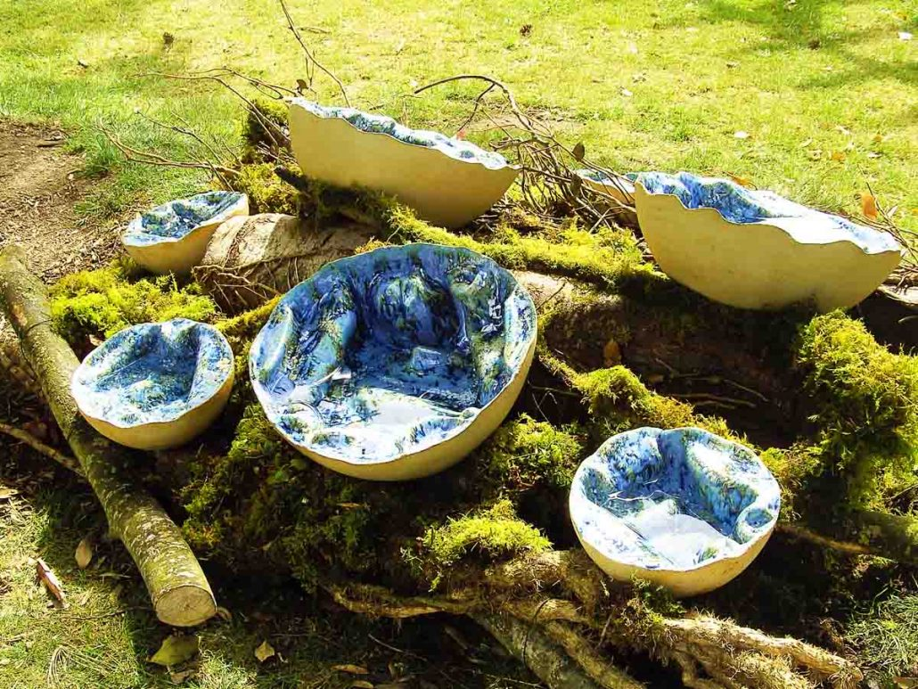 Outdoor ceramic water sculpture - Puffballs: From the inside out by Michelle Maher. Shown here at Design & Crafts Council of Ireland Sculpture trail at Bloom 2008. This sculpture is inspired by the internal structure of Puffball fungi and seascapes from the Burren in Co. Clare. They were hand sculpted and modelled in a grogged stoneware clay body and fired in an electric kiln to 1260°C (Cone 8). Now part of the permanent collection at Blarney Castle. www.ceramicforms.com.