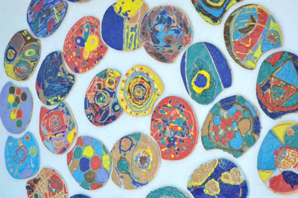 Public Art Project 2010 by ceramic artist Michelle Maher & the children & staff Scoil Thomáis, Laurel Lodge in Dublin 15.Collaborative Art Project through the Crafts Council of Ireland CRAFTed initiative. We drew inspiration from repeating patterns in nature to create a spiral wall sculpture.www.ceramicforms.com