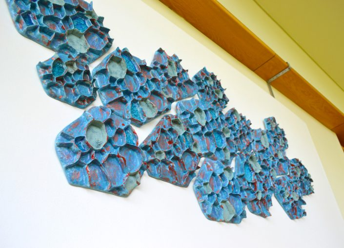 Ceramic wall sculpture - '120 degrees' by Michelle Maher. Shown here at Sculpture in Context 2018 at The National Botanic Gardens in Dublin. It is inspired by repeating polygon patterns we find in nature. The pieces were hand built & sculpted in a cranked clay body and high fired in an electric kiln to 1260 C. www.ceramicforms.com