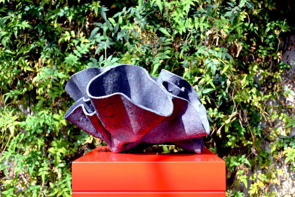Ceramic sculpture - 'The Folded Line' by Michelle Maher. Shown here at Sculpture in Context 2019 at The National Botanic Gardens in Dublin. Inspired by Fungi , it was sculpted in my own grogged paper clay body and high fired in an electric kiln to Cone 9. www.ceramicforms.com