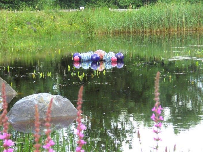Award winning ceramic water sculpture by Michelle Maher - Pollen Hotspot. Shown here Shown here in the Lochan at Brigit's Garden, Co. Galway. The piece is inspired by microscopic pollen grains - measured in nanometers these tiny grains are perhaps natures greatest sculptures. See www.ceramicforms.com
