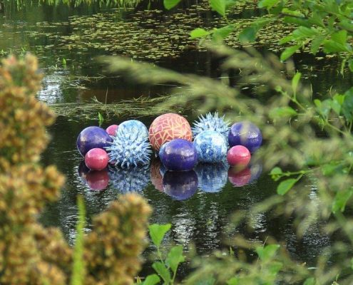 Award winning ceramic water sculpture by Michelle Maher - Pollen Hotspot. Shown here in the pond at The National Botanic Gardens in Dublin. The piece is inspired by microscopic pollen grains - measured in nanometers these tiny grains are perhaps natures greatest sculptures. www.ceramicforms.com