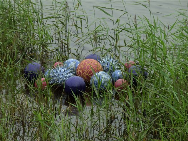 Award winning ceramic water sculpture by Michelle Maher - Pollen Hotspot. Shown here in Clare lake at the Claremorris Open Exhibition, Co. Mayo. The piece is inspired by microscopic pollen grains - measured in nanometers these tiny grains are perhaps natures greatest sculptures. www.ceramicforms.com