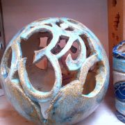 Hand built sphere lamp by Aideen McDonald at Dublin based ceramics weekend course. The piece features the Om symbol ॐ. Electric fired to 1260°C (Cone 8). www.ceramicforms.com