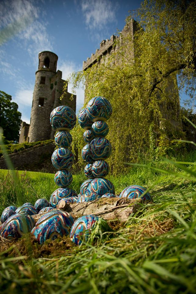 Ceramic outdoor sculpture - Surface Tension by Michelle Maher. This ceramic sculpture was inspired by the science of bubbles and is shown here at Blarney Castle, Co.Cork for Sculpture at the Castle 2014. It was hand built with Sgraffito marks using a grogged crank clay body and high fired in an electric kiln to 1260°C (Cone 8). www.ceramicforms.com Photo by Christian Haubold http://bridgemountphoto.com/, with permission.