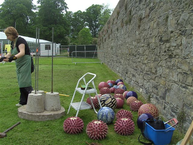 Installation process. Award winning ceramic outdoor culpture by Michelle Maher - Pollen Hotspot and The Dahlia: Loud and Proud. Shown here at the National Craft Gallery Garden at Bloom 2009, the Phoenix Park, Dublin. All pieces were hand sculpted and high fired in an electric kiln to 1260°C (Cone 8). www.ceramicforms.com.