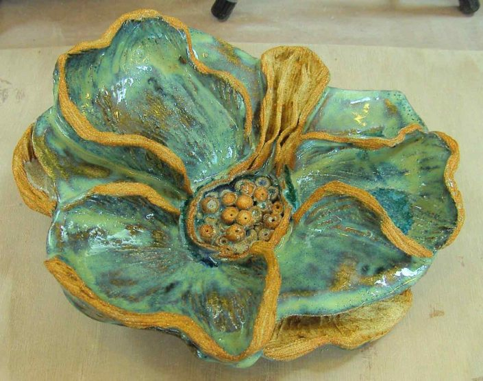Hand built and modelled vessel by Lorraine Kelly O'Connor. In crank clay body at Dublin based Tuesday morning pottery course. Glazed in a copper pearl glaze & electric fired to 1260°C (Cone 8). www.ceramicforms.com
