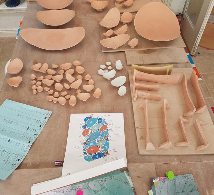 Studio Process - glazing. 'The Space In Between' by Michelle Maher is inspired by the microscopic world of plant cells – in particular, vascular bundles in plant stems. Consisting of 106 pieces it was hand built in a cranked clay body and high fired in an electric kiln to 1260 C. www.ceramicforms.com