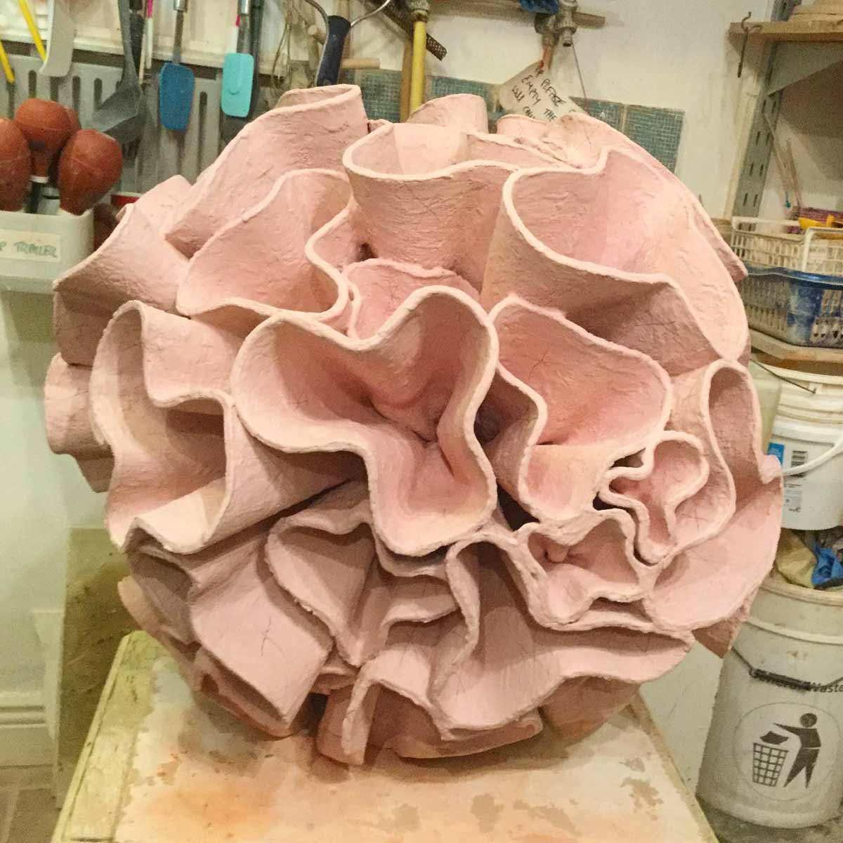 Ceramic water sculpture 'Synthesis' by Michelle Maher. Here is 'Synthesis' just before being loaded for the final glaze firing. This will be a dark red glaze after firing. Each bracket was sculpted individually. To be exhibited at Sculpture in Context 2016 at The National Botanic Gardens in Dublin. Inspired by Dahlia and Coral forms, it was handmade in my own grogged paper clay body and high fired in an electric kiln to 1260°C (Cone 8). www.ceramicforms.com