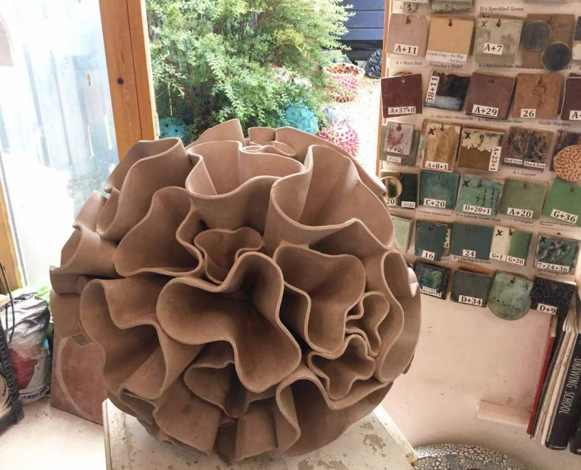 Ceramic water sculpture 'Synthesis' by Michelle Maher. Studio process - here we see my 'Synthesis' sculpture drying in my studio before firing. Each bracket was sculpted individually. To be exhibited at Sculpture in Context 2016 at The National Botanic Gardens in Dublin. Inspired by fungi and coral forms, it was handmade in my own grogged paper clay body and high fired in an electric kiln to 1260°C (Cone 8). www.ceramicforms.com