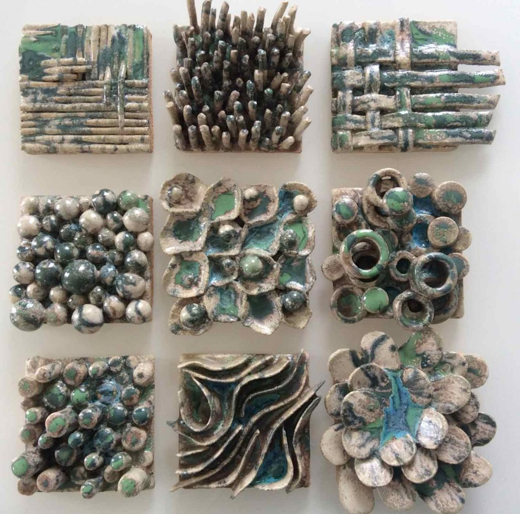 Hand built and modelled wall tiles by Evelyn D'Arcy Synott. Created in Dublin based Wednesday evening ceramics course. Tiles have 3 layers of glaze as well as glass detail. Fired in an electric kiln to 1260°C (Cone 8). www.ceramicforms.com
