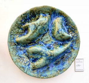 Puffballs Wall Piece by Michelle Maher. This wall sculpture is inspired by the internal structure of Puffball fungi and seascapes from the Burren in Co. Clare. Hand sculpted and modelled in a grogged stoneware clay body and fired in an electric kiln to 1260°C (Cone 8).