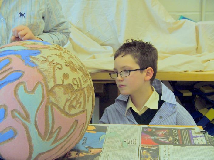Collaborative Process. Public Art Project 2010 by ceramic artist Michelle Maher & the children & staff at St. Patrick's N.S., Diswellstown, Dublin 15. Working in collaboration with the three fourth-class groups, we created two large-scale spherical sculptures 1.5 and 2 metres in height and the children's footprints in clay. The finished work was permanently installed in the new school garden and on the school roundabout.