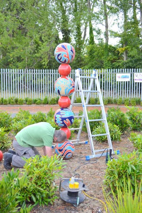 Installation. Public Art Project 2010 by ceramic artist Michelle Maher & the children & staff at St. Patrick's N.S., Diswellstown, Dublin 15. Working in collaboration with the three fourth-class groups, we created two large-scale spherical sculptures 1.5 and 2 metres in height and the children's footprints in clay. The finished work was permanently installed in the new school garden and on the school roundabout. www.ceramicforms.com