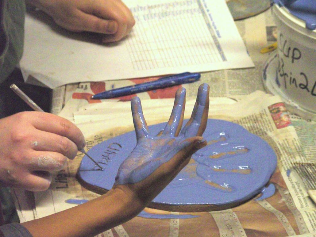 Hand Print Process. Large-scale Collaborative Public Art Commission 2009 with St. Peter's National School, Phibsborough, Dublin. This project celebrated the opening of their new school building and had a strong collaborative element between Ceramic Artist Michelle Maher and the whole school community. We took the handprints in clay and slip of all pupils, teachers and staff and created a series of three large-scale ceramic wall murals.www.ceramicforms.com