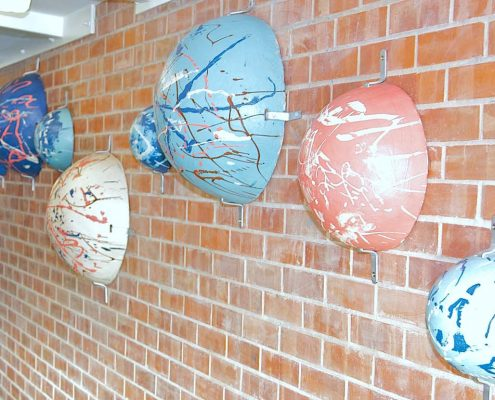 St. Peter's Solar Sytem. Large-scale Collaborative Public Art Commission 2009 with St. Peter's National School, Phibsborough, Dublin. This project celebrated the opening of their new school building and had a strong collaborative element between Ceramic Artist Michelle Maher and the whole school community. We took the handprints in clay and slip of all pupils, teachers and staff and created a series of three large-scale ceramic wall murals. www.ceramicforms.com. Photo by Trevor O'Rourke - Picturehouse Photography.