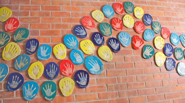 Hand Print Project. Large-scale Collaborative Public Art Commission 2009 with St. Peter's National School, Phibsborough, Dublin. This project celebrated the opening of their new school building and had a strong collaborative element between Ceramic Artist Michelle Maher and the whole school community. We took the handprints in clay and slip of all pupils, teachers and staff and created a series of three large-scale ceramic wall murals. www.ceramicforms.com Photo by Trevor O'Rourke - Picturehouse Photography.