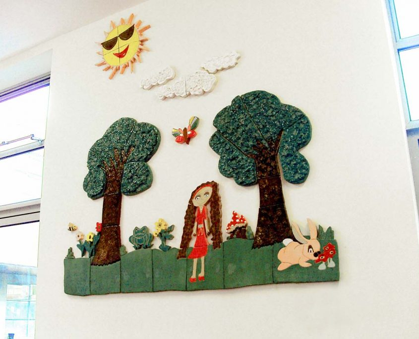 Woodland Mural. Large-scale Collaborative Public Art Commission 2009 with St. Peter's National School, Phibsborough, Dublin. This project celebrated the opening of their new school building and had a strong collaborative element between Ceramic Artist Michelle Maher and the whole school community. We took the handprints in clay and slip of all pupils, teachers and staff and created a series of three large-scale ceramic wall murals. www.ceramicforms.com