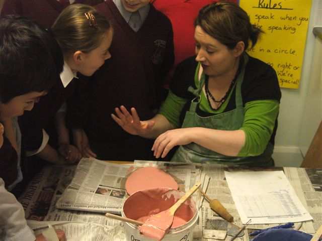 Hand Print Project in process. Large-scale Collaborative Public Art Commission 2009 with St. Peter's National School, Phibsborough, Dublin. This project celebrated the opening of their new school building and had a strong collaborative element between Ceramic Artist Michelle Maher and the whole school community. We took the handprints in clay and slip of all pupils, teachers and staff and created a series of three large-scale ceramic wall murals. www.ceramicforms.com